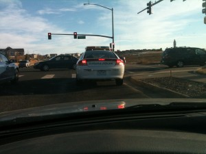 An Aurora police car at an intersection. Photo by S.L. Alderton
