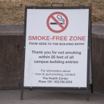 Signs placed near two entrances to the Plaza Building remind students of the 25-foot smoke-free zone around building entrances.  Photo by Melanie J. Rice • mrice20@msudenver.edu