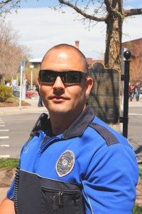 """""""It's something new every day"""": Officer Jason Skeen deals with the day-to-day issues resulting from the many people who visit the campus. [Photo by Tom Skelley]"""