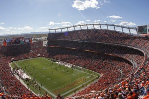 Photo cutline for Sports Authority Field packed with fans This photo of Sports Authority Field at Mile High, the home of the Denver Broncos, shows what a sold-out crowd looks like in a stadium with a capacity of about 77,100. This can be compared to crowd photos of Civic Center to get an idea of how different crowd sizes appear. (Photo by Denver Broncos team photography)